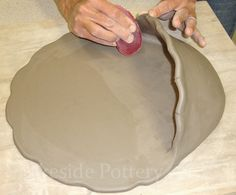 making clay holy water font