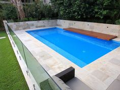 Eco Outdoor Beauford sandstone paving used as pool surround with Berrimah sandstone walling. Eco Outdoor | Christopher Owen Landscape Design Sydney | Retaining wall | Stone veneer | Stone walling | Stone wall cladding | Sandstone paving | Pool ideas | Pool paving | sandstone pool | sandstone tiles