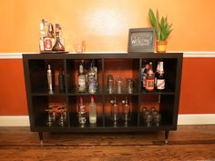 DIY bar from bookshelf, this is a flexible option and looks nice.  I think a framed chalkboard could be fun hung above it, or the wine racks.