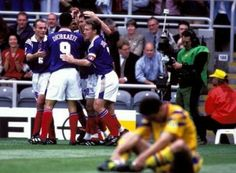 France 1 Romania 0 in 1996 at St James Park. Christophe Duggary is mobbed after scoring on 25 minutes in Group B at Euro '96.