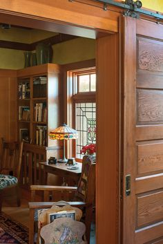 Five-Panel Doors Slide on Barn-Door Tracks in a Craftsman-Inspired Home on the Oregon Coast | American Bungalow