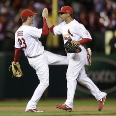 Cardinals third baseman David Freese and center fielder Jon Jay celebrate after the final out during Game 3. 10-17-12