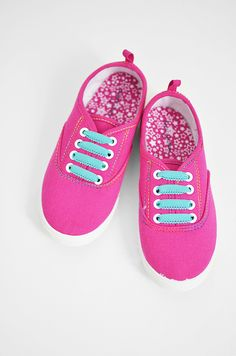 Kid-friendly Elasticized Sneakers DIY - Simply replace the laces with cute elastic.