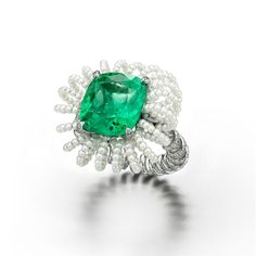 Suzanne Syz Picture Perfect ring in white gold and titanium, set with a Colombian emerald, diamonds and pearls. Courtesy of Suzanne Syz