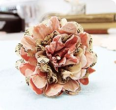 Flower created using dampened scalloped paper circles.