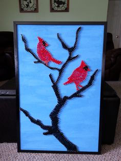 Bird String Art with Cardinals. Used Linoleum nails and painted cork bulletin board. Easy and fast nailing when using a cork board but be careful how tight you wrap the string or the nails bend inward
