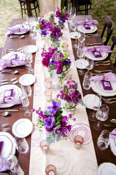 i can see this with aquamarine napkins and orange and blue flowers included with the purple - haley
