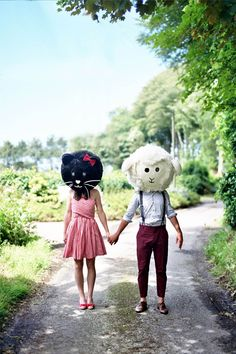 A Garden Engagement with Giant Animal Heads: Elodie & Alexis