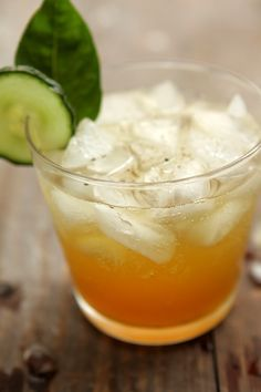A refreshing cocktail recipe featuring Pimm's, gin, cucumber & lemon-basil syrup served over ice.