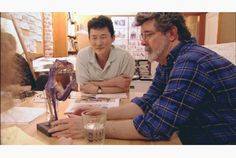 Star Wars concept artist Doug Chiang, left, chats with series creator George Lucas.