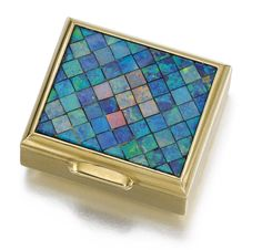 GOLD AND OPAL PILL BOX, CARTIER, 1953 Of rectangular form, the lid embellished with a mosaic of black opals, the sides and reverse with reeded decoration