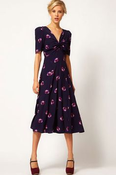 ASOS Midi Dress In Floral Print With Twist Front, $70.36, available at ASOS.