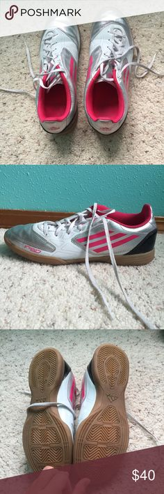 Adidas F-50 Indoor Soccer Shoes Pink, grey, and white indoor soccer shoes. They were only worn for games, never practice, so they've been played in a max of 8 times. Very new condition. As with all soccer shoes, there's a few scuffs here and there, but nothing major and I think if cleaned they will come out. No trades, but open to reasonable offers. Adidas Shoes Athletic Shoes