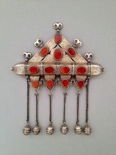A spectacular and glowing tumar ornament in silver, gilt, and carnelian.  From the collection of Tesori Orientali.  Turkmenistan, Turkoman:Tekke people. Tumar, 7 inches wide.