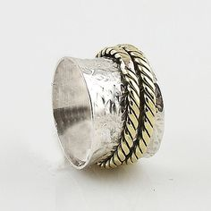 Solid Sterling Silver and Bronze Spinner Ring DETAILS: * Size 7 * 5.4 g total…