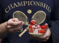 A spectator eats strawberries and cream at the Wimbledon Tennis Championships, in London Wimbledon Strawberries And Cream, When In French, Hottest Wags, Office Christmas Party, Wimbledon Tennis, Seaside Decor, Tennis Championships, Blue Streaks, Beauty