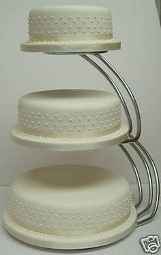 A Midsummer Night Dreams Wedding cake with flowerpaste sweet