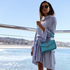$1,690 JW Anderson Pierce Medium Leather Shoulder Bag Teamed With Blue Striped Shirt Dress And Oversized Frame Sunglasses Plus Drop Hoop Earrings Vacation Summer Outfit Ideas Blogger Mytheresa
