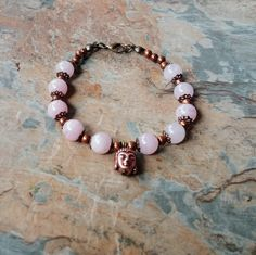 Rose quartz with copper Buddahs head charm and copper detail and lobster clasp handmade bracelet. Also available with matching Buddah head earings. Thank you for your time. Handmade Beads, Handmade Bracelets, Beaded Bracelets, Necklaces, Bridesmaid Jewelry, Bridal Jewelry, Copper Bracelet, Rose Quartz, Jewelry Design