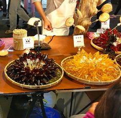 Colourful triangular shaped sugar lollies at the night market in Zhongli…