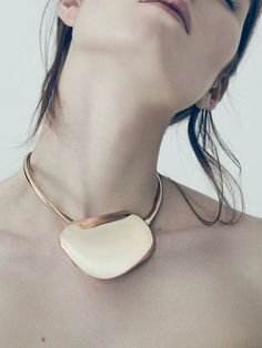 Bold. Artistically elegant... Versatility in seriousness and playfulness. Gold a plus. I love a good statement piece.