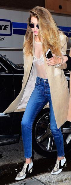 Gigi Hadid looking flawless in a totally sheer top and amazing Rodarte booties.