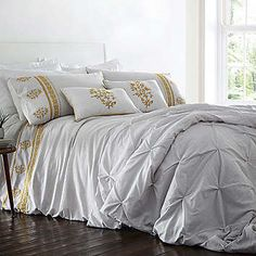 Deluxe embroidery on a gentle printed grey pinstripe in this seasons on trend Ochre colour. Duvet set comprises of duvet cover and pillowcase(s), one with the single and two with the double, king and super king. Layer up with a deluxe pinched quilted throw and an embroidered boudoir cushion.Duvet Set Features: Washable 52% Polyester, 48% Cotton