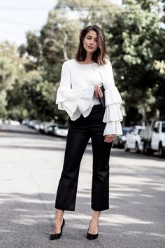 White blouse with bell sleeves and black cropped pants
