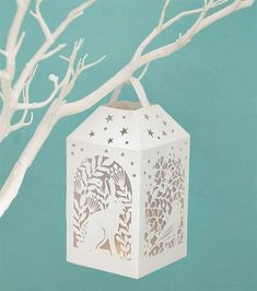 Learn how to create your own woodland lantern with this exclusive template and a simple craft knife.
