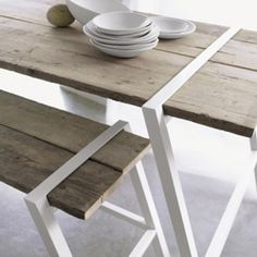 Laquered metal + recycled wood table. Contrast