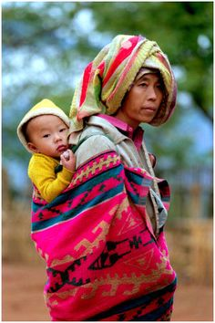 t-a-h-i-t-i:    world—at—large:    World—at—Large:  Hmong Women with child -BY- Hans Hendriksen