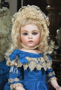 I just love antique dolls, some may find them a tad eerie but I adore them.