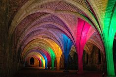 Colored lights illuminated Fountains Abbey in Yorkshire, England Adventure Time, Adventure Travel, Places To Travel, Places To Go, Somewhere Over, Dance Photos, World Of Color, Ancient Art, Art And Architecture
