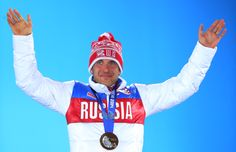 Bronze medalist Evgeniy Garanichev of Russia celebrates during the medal ceremony for the Men's Individual 20 km (c) Getty Images
