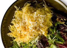 Roasted Spaghetti Squash with cheese. Omit cheese (or use Daiya) to veganize.