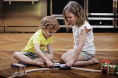 #Playing with #trains together! #Brotherhood moments. LINDA top and CAOUETTE shorts for her = ANDY T-shirt and JACK shorts for him #cdec_paris