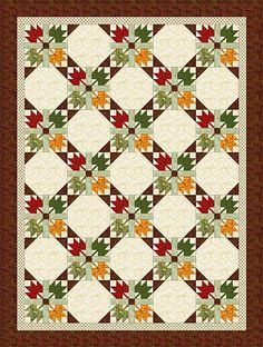 A free quilt pattern made with Maple Leaf and another easy quilt block, and designed to showcase the changing of seasons.