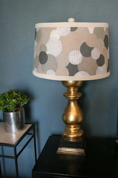 Recycle & recover lampshade.....anthropologie style....use any coordinating fabrics....cut circles....glue on....