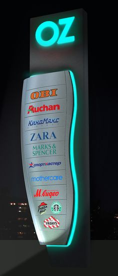 Oz is the retail brand name of AIM, a Turkish-Russian consortium. The OZ brand of shopping malls were conceived as chain of malls to span Russian string cities from Saratov to Omsk. Pylon Signage, Wayfinding Signage, Signage Design, Environmental Graphic Design, Environmental Graphics, Standing Signage, Monument Signs, Sign System, Retail Signage