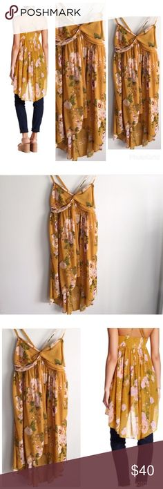 NWT free people tunic tank Free people mirage Tunic tank mustard yellow with a floral print.looks great with skinny jeans or shorts Free People Dresses Asymmetrical