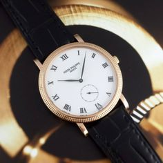 ⌚Porcelain Prestige⌚  A classical #PatekPhilippe #Calatrava ref.#3919 in 18k rose gold. This one features a beautiful white #porcelain dial with roman numerals.
