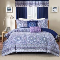 "<p>With an enchanting bohemian medallion print, our Calhoun comforter set adds calming color to your bedroom in soft shades of plum and navy.</p><div style=""page-break-after: always;""><span style=""display: none;"">"