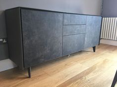 Stylish modern BOOK sideboard. Sideboard on steel legs with matt glass frame and ceramic door fronts. Consists of 2x door module and 1x set of drawers. Delivered to our client in Surrey.