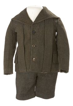 Boy's Suit  Date: ca. 1900  This boy's jacket and short pants are made of wool tweed, and are styled in the sailor look that was popular for...