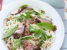 This fresh and fragrant Thai beef salad with chilli and lime gets a powerful kick from its fish sauce based dressing. One of the classic dishes of Thai cuisine and a favourite on restaurant menus the world over. Lime Recipes, Beef Recipes, Salad Recipes, Thai Beef Salad, Asian Beef, Fish Sauce, Menu Restaurant, Yummy Food, Lunch