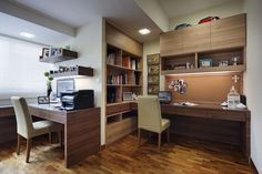 Modern home office buit for two people to work in.