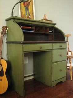 I don't know how practical it would be, but I love the idea of having an old roll-top desk. :)