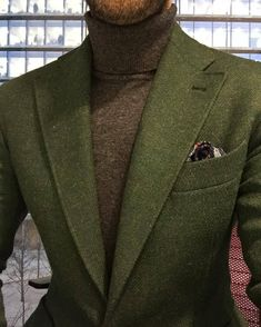 A great winter look. A wool green jacket and a turtle neck are destined to keep you warm at the coldest events