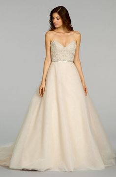 A Beautiful Ombre Wedding Dress With Flower Embroidered On The