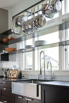 Beautiful contemporary kitchen! The thin profile shelves, the deep stainless steel sink, and the dark wood for the cabinets where very tasteful choices. If you love home inspiration pins, follow @Porch for the best - we love pinning for you!
